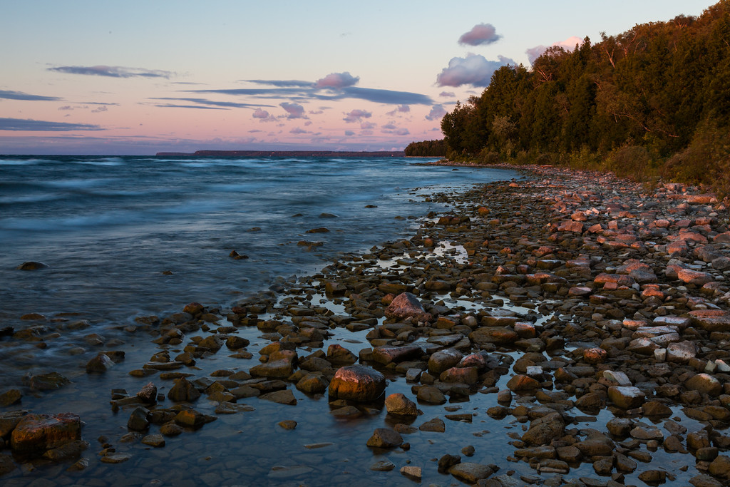 Rocky shore of Peninsula State Park at sunset. Peninsula State Park, WI<br /> <br /> WI-100904-0142