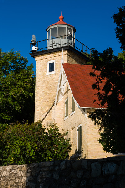 Late Afternoon light bathes the Eagle Bluff Lighthouse. Peninsula State Park, WI<br /> <br /> WI-080830-0114