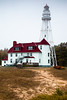 Fog and rain descends on the Rawley Point Lighthouse. Two Rivers, WI<br /> <br /> WI-100513-0009