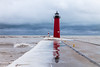 As winter releases its stronghold, waves once can be seen by the Kenosha Pierhead Light. Kenosha, WI<br /> <br /> WI-100124-0032