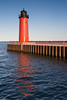 The Milwaukee Pierhead Light reflects on the Lake Michigan waters. Milwaukee, WI<br /> <br /> WI-080811-0323