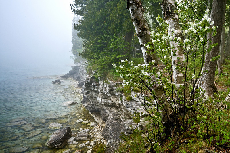 WI 007                             Fog rolls in along the rocky shoreline of Cave Point County Park in Door County, Wisconsin.