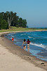 Children stroll the shore of Lake Michigan on a warm late summer afternoon. Sturgeon Bay, WI<br /> <br /> WI-080901-0190