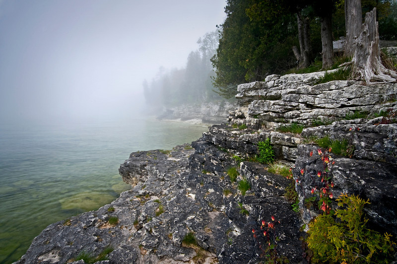 WI 004                               Fog rolls in along the rocky shoreline of Cave Point County Park in Door County, Wisconsin.