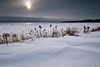 WI 085                          Pale winter sunlight illuminates the contours of drifted snow on the shore of Europe Bay, Newport State Park, Door County, WI.