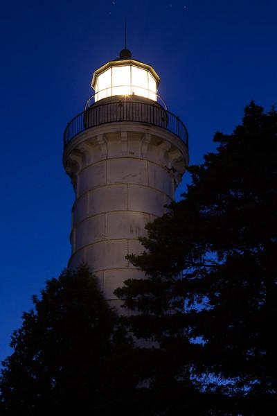 The Cana Island Light glows at night. Light tower was illuminated using a small flashlight. Cana Island, WI<br /> <br /> WI-090905-0091