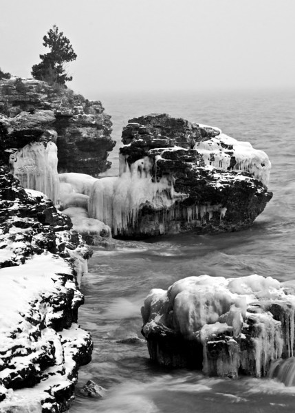 WI 098                            Ice formations cover the rugged shorline of Cave Point County Park, Door County, Wisconsin.