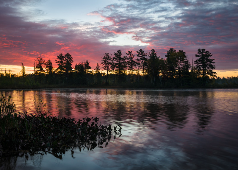 WI 211<br /> <br /> An autumn day begins in northern Wisconsin with a beautiful sunrise over a secluded northwoods lake.