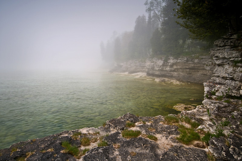 WI 006                                Fog rolls in along the rocky shoreline of Cave Point County Park in Door County, Wisconsin.