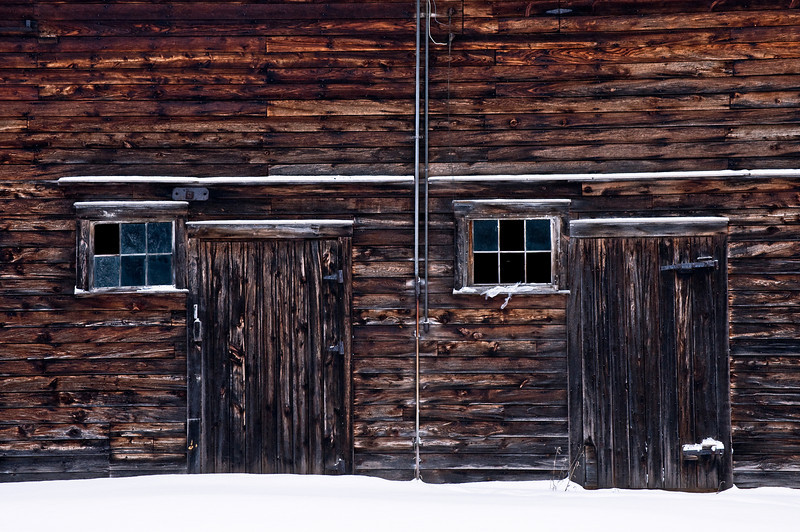 WI 086                          Twin doors and windows on the side of a weathered barn, Door County, WI.