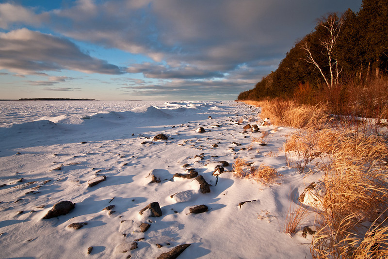 WI 104                          Sunset light on the winter shoreline of Peninsula State Park in Door County, Wisconsin.