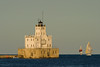 Sailboats sail the the Lake Michigan waters near the Milwaukee Pierhead Lighthouse. Milwaukee, WI<br /> <br /> WI-080811-0335