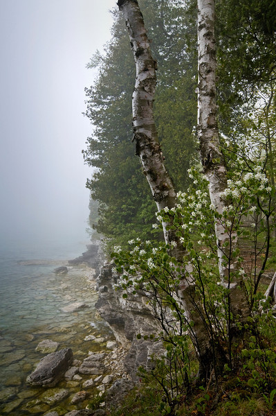 WI 009                            Fog rolls in along the rocky shoreline of Cave Point County Park in Door County, Wisconsin.