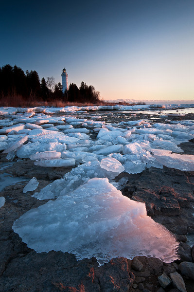 WI 091                         Chunks of ice washed up along the shoreline of Cana Island glow in the light of the rising sun on a frigid January morning in Door County, Wisconsin.