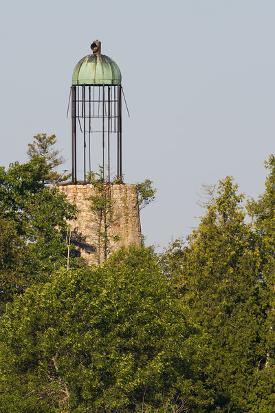 The Old Baileys Harbor Light featured one of the last bird cage lanterns. The structure dates back to 1852 and is currently in disrepair. The light station  is on private property  but the remains of the tower can be seen from a distance towering across the tree line. Baileys Harbor, WI<br /> <br /> WI-080831-0045