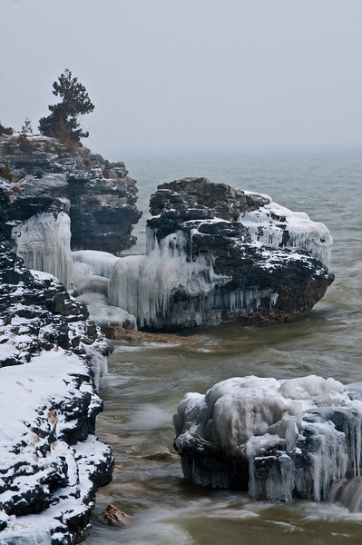 WI 099                            Ice formations cover the rugged shorline of Cave Point County Park, Door County, Wisconsin.