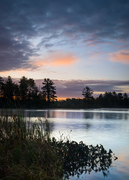 WI 212<br /> <br /> A peaceful start to an autumn day as sunrise colors creep across the sky over a secluded Northwoods lake.  Oneida County, Wisconsin.