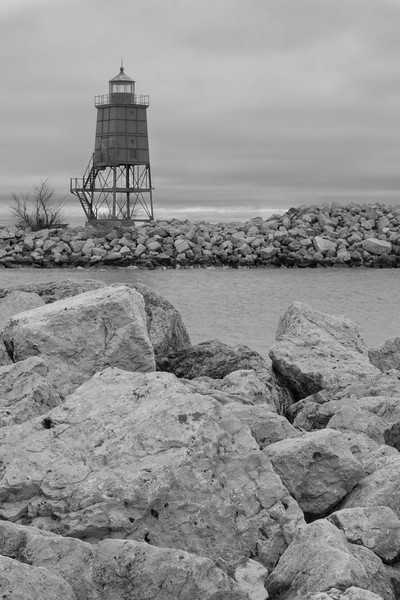 The Racine Light keeps an eye over the channel leading up to the marina. Racine, WI<br /> <br /> WI-100124-0172