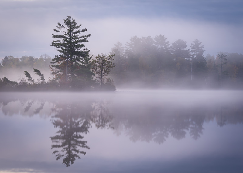 WI 213<br /> <br /> Mist rises up from the calm surface of a secluded northwoods lake just before sunrise on an autumn morning.  Oneida County, Wisconsin.