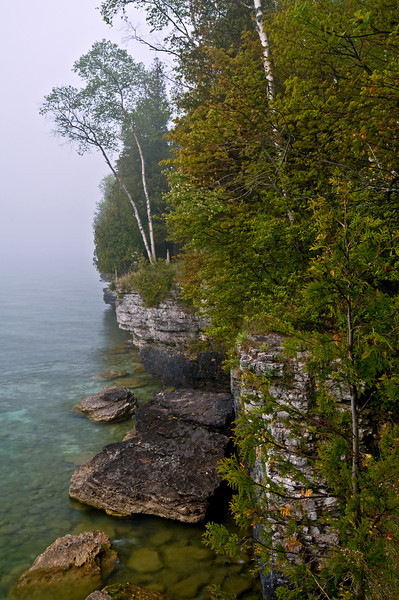 WI 002                           Fog rolls in along the rocky shoreline of Cave Point County Park in Door County, Wisconsin.