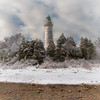 A winter view of one of Door County's most popular lighthouses the light has been guiding mariners on Lake Michigan for more than 140 years. <br /> <br /> The island is 8.7-acre and light tower is 89 feet tall. The original home of the lighthouse keeper and the oil house where fuel for the light was stored are all intact still to this day. The outside deck delivers a 360 degree view of Lake Michigan and the Door County peninsula.