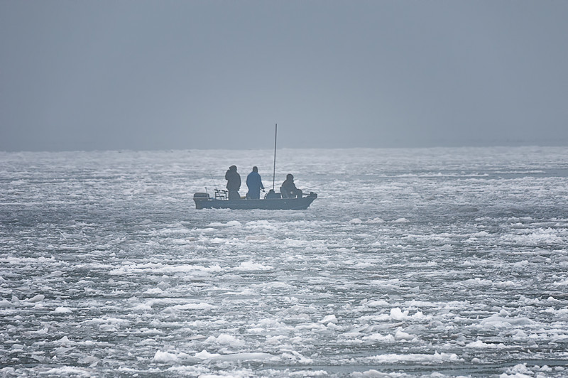 Fisherman brave the harsh elements,wind, rain, cold, fog and ice man must fish!