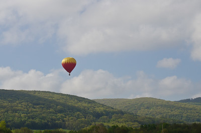 Hot Air Balloon Flying Above the Mountains on a Hazy Morning
