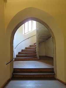 Note that this spiral staircase spirals the opposite direction of almost all other staircases. The typical spiral staircase of castles etc spin the other direction so that in a sword fight the person higher up the stairs had the advantage - assuming they were right handed