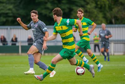 Scott Bakkor (Witton Albion) advances forward