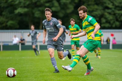 Tom Owen's chases down a Runcorn defender