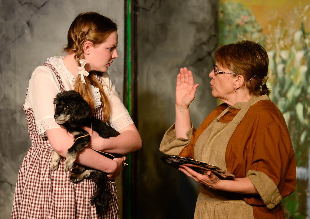 . LONGMONT, CO - APRIL 16:Anna Ramsey, as Dorothy, holding Lily, as Toto, and Ann Massengill, as Auntie Em, during a rehearsal for Wizard of Oz at Jesters Dinner Theater in Longmont on April 16, 2019. (Photo by Matthew Jonas/Staff Photographer)