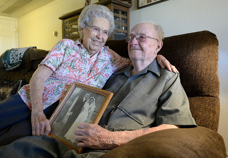 Fern and Warren Wolaver hold their wedding photo from 1939 while reminiscing about their lives together Thursday, Oct. 5, 2017, in their apartment at The Wexford assisted living in Loveland. The two celebrate their 78th wedding anniversary on Friday. (Photo by Jenny Sparks/Loveland Reporter-Herald)