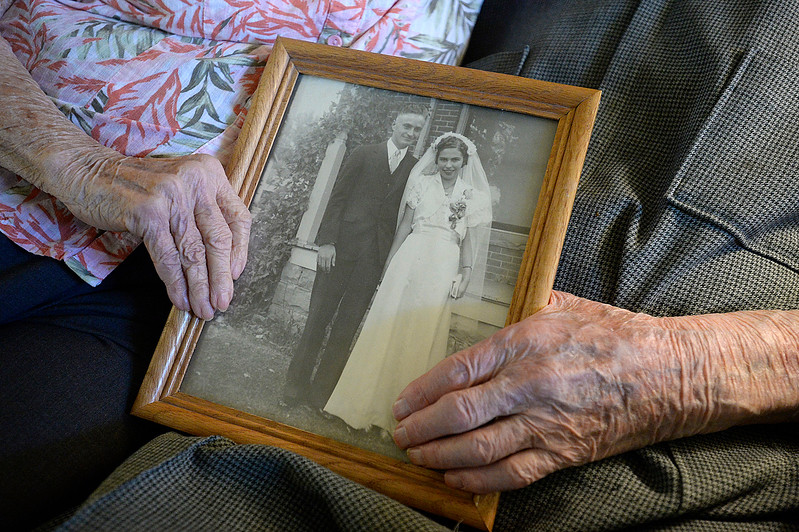 Fern and Warren Wolaver hold their wedding photo Thursday, Oct. 5, 2017, in their apartment at The Wexford assisted living in Loveland. The two celebrate their 78th wedding anniversary on Friday. (Photo by Jenny Sparks/Loveland Reporter-Herald)