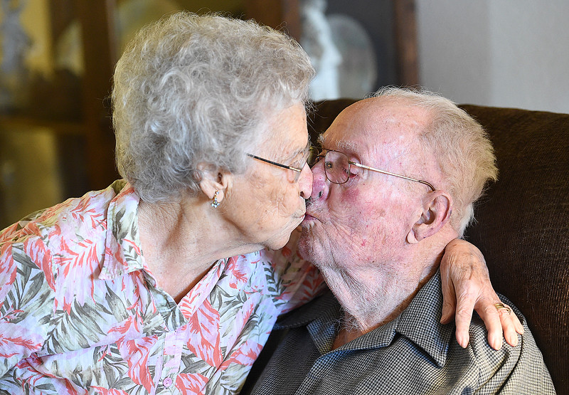 Fern and Warren Wolaver share a smooch Thursday, Oct. 5, 2017, in their apartment at The Wexford assisted living in Loveland. The two celebrate their 78th wedding anniversary on Friday. (Photo by Jenny Sparks/Loveland Reporter-Herald)