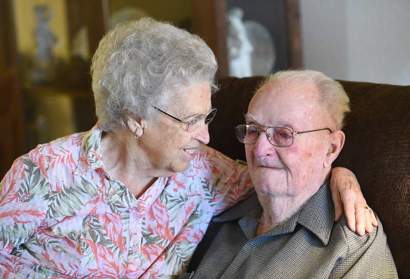 Fern and Warren Wolaver reminisce about their many married years Thursday, Oct. 5, 2017, in their apartment at The Wexford assisted living in Loveland. The two celebrate their 78th wedding anniversary on Friday. (Photo by Jenny Sparks/Loveland Reporter-Herald)