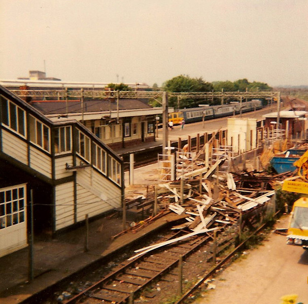 Demolition is almost complete of the main building on platform 4. The building at the rear still standing is the toilet block. A 310 unit pulls into platform 2 for Euston as obviously platform 4 was unsafe for passengers during demolition. Photograph taken on 17 June 1984.