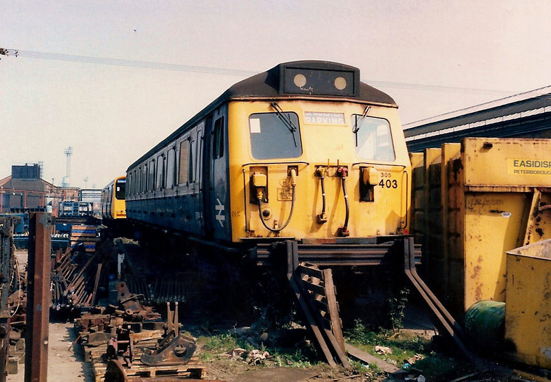 Up against the buffer stops, vehicle 76464 from 305403 is espied inside the works on 17 April 1987.