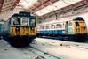Vehicles from 310077 and 305451 under repair inside Wolverton Works on 17 April 1987.