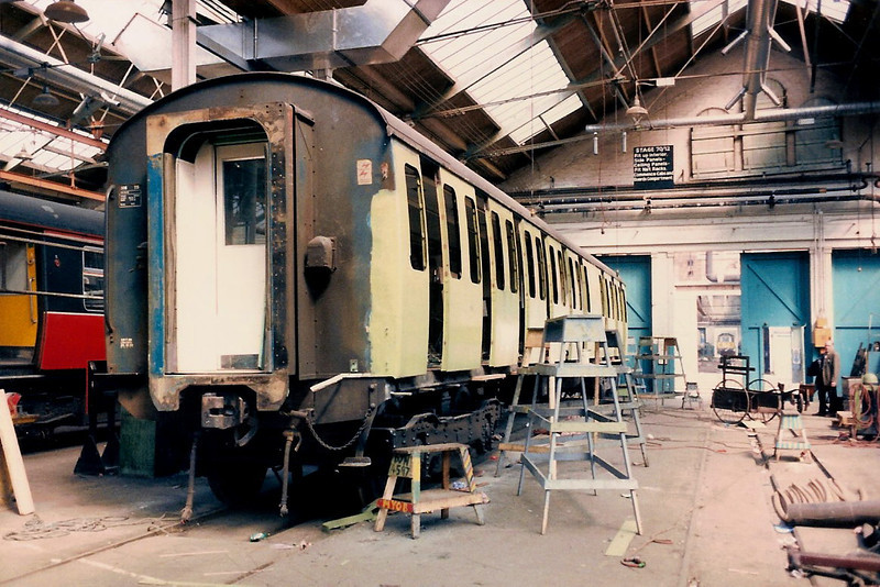 A complete new side is seen having been fitted to an unidentified vehicle from 308165 inside the West Repair Shop on 17 April 1987. My Dad is also included to the right of picture.