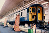 Up in the air ! A vehicle from Clacton - Walton 309602 under repair in the Traction Shop inside the works on 17 April 1987.