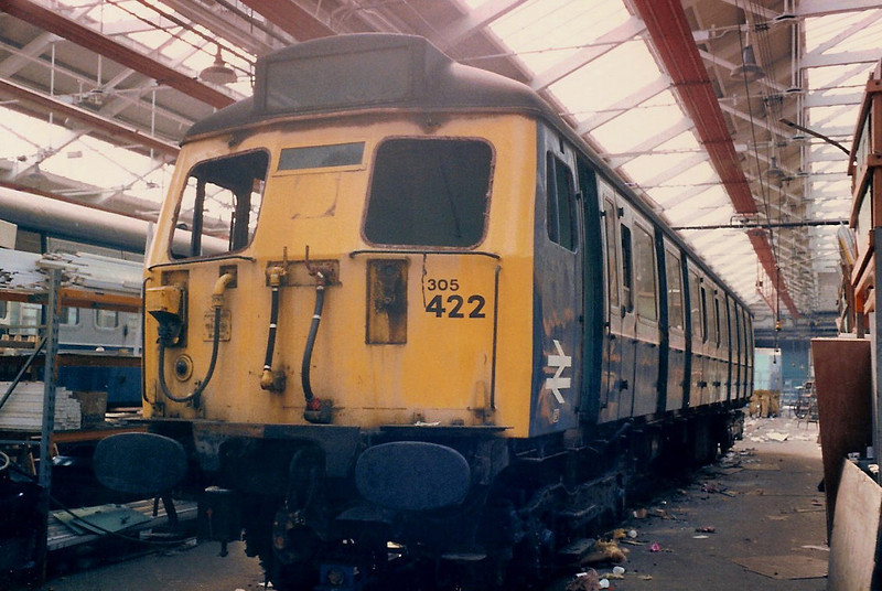 A driving vehicle from 305422 looking worse for wear inside the East Repair Shop inside Wolverton Works on 17 April 1987.