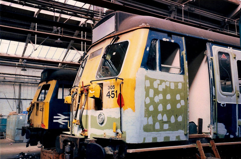 Vehicles from 305422 and 305451 under repair in the East Repair Shop inside Wolverton on 17 April 1987.