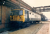 Vehicle 78017 from unit 312718 stands in the yard outside the East Repair Shop on 17 April 1987.