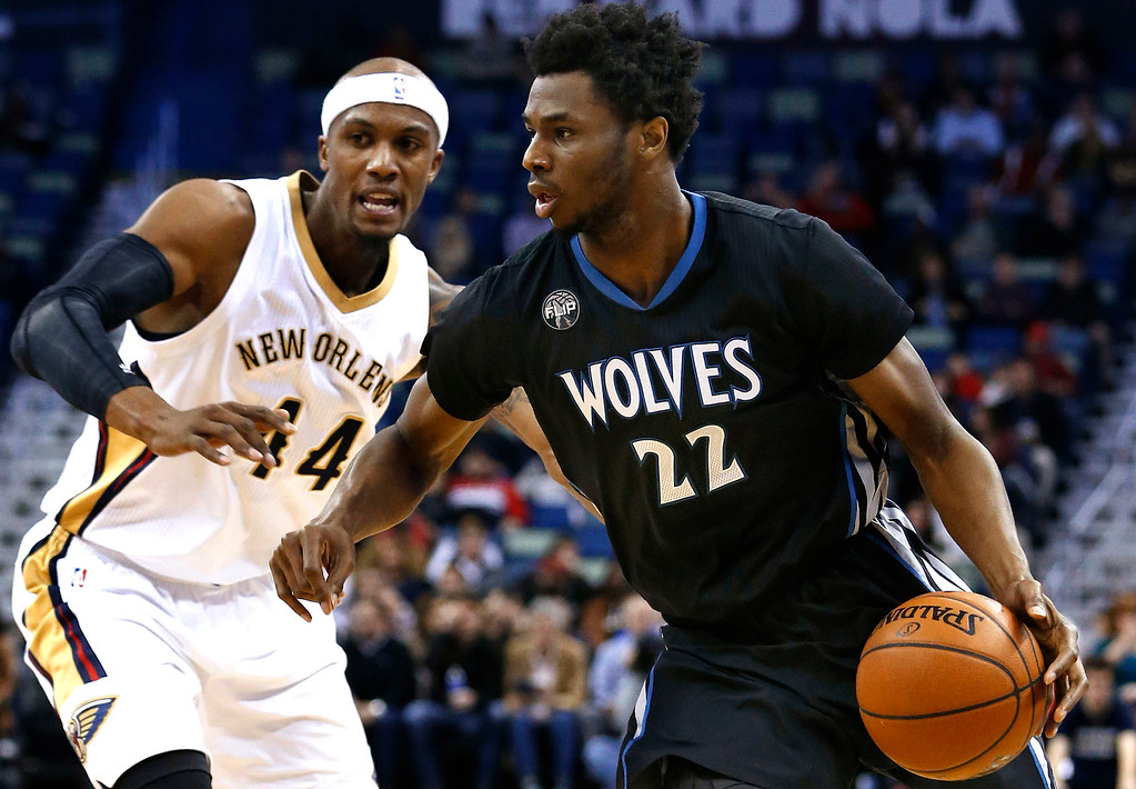. Minnesota Timberwolves guard Andrew Wiggins (22) drives against New Orleans Pelicans forward Dante Cunningham (44) during the first half of an NBA basketball game Tuesday, Jan. 19, 2016, in New Orleans. The Pelicans won 114-99. (AP Photo/Jonathan Bachman)