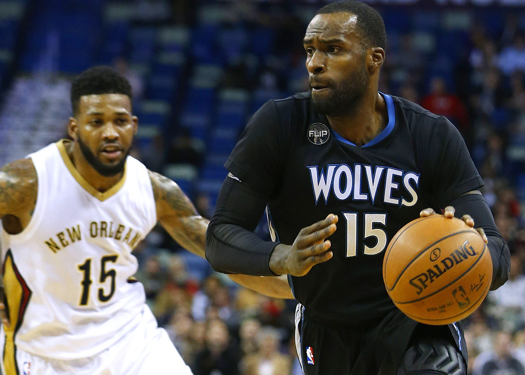 . Minnesota Timberwolves forward Shabazz Muhammad (15) drives against New Orleans Pelicans forward Alonzo Gee (15) during the first half of an NBA basketball game Tuesday, Jan. 19, 2016, in New Orleans. The Pelicans won 114-99. (AP Photo/Jonathan Bachman)