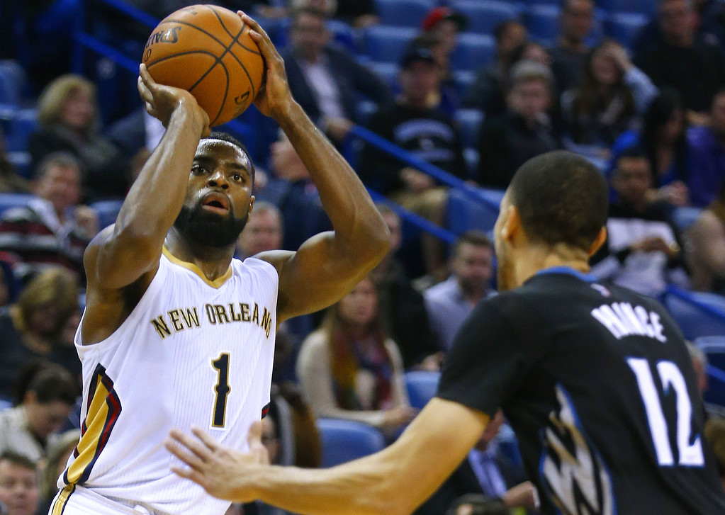 . New Orleans Pelicans guard Tyreke Evans (1) shoots over Minnesota Timberwolves forward Tayshaun Prince (12) during the second half of an NBA basketball game Tuesday, Jan. 19, 2016, in New Orleans. The Pelicans won 114-99. (AP Photo/Jonathan Bachman)