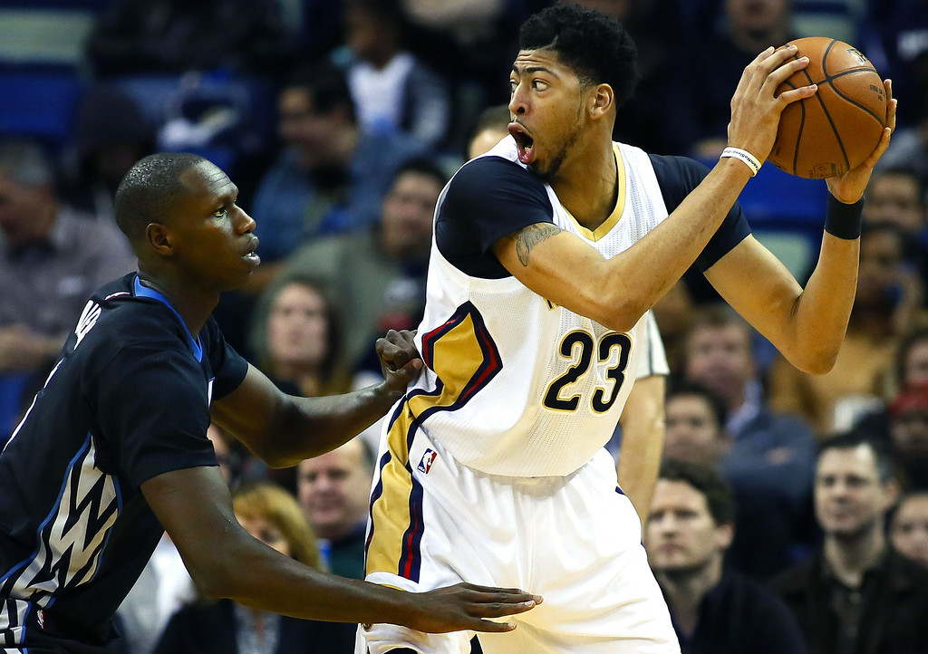 . New Orleans Pelicans forward Anthony Davis (23) drives against Minnesota Timberwolves center Gorgui Dieng, left, during the first half of an NBA basketball game Tuesday, Jan. 19, 2016, in New Orleans. (AP Photo/Jonathan Bachman)