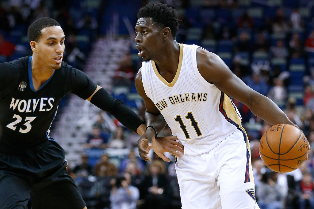 . New Orleans Pelicans guard Jrue Holiday (11) drives against Minnesota Timberwolves guard Kevin Martin (23) during the second half of an NBA basketball game Tuesday, Jan. 19, 2016, in New Orleans. The Pelicans won 114-99.(AP Photo/Jonathan Bachman)