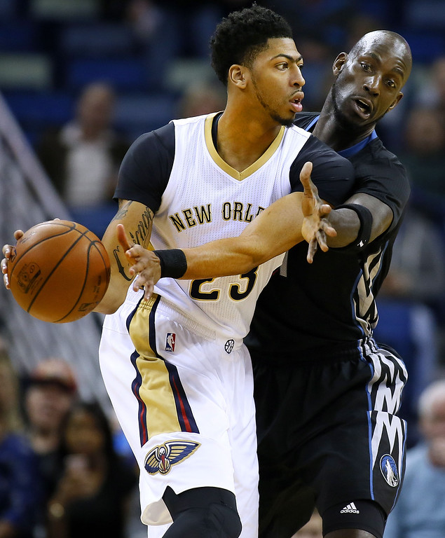 . New Orleans Pelicans forward Anthony Davis, left, drives against Minnesota Timberwolves forward Kevin Garnett during the first half of an NBA basketball game Tuesday, Jan. 19, 2016, in New Orleans. (AP Photo/Jonathan Bachman)