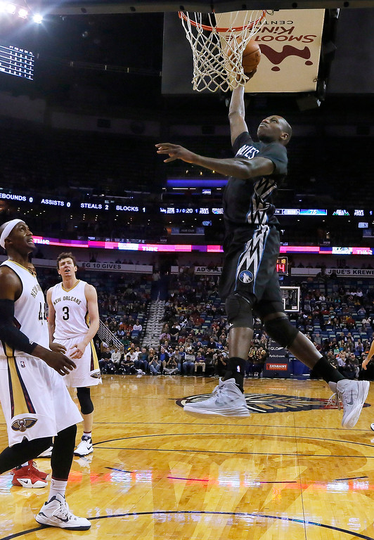. Minnesota Timberwolves center Gorgui Dieng dunks in front of New Orleans Pelicans forward Dante Cunningham (44) and center Omer Asik (3) during the second half of an NBA basketball game Tuesday, Jan. 19, 2016, in New Orleans. The Pelicans won 114-99. (AP Photo/Jonathan Bachman)